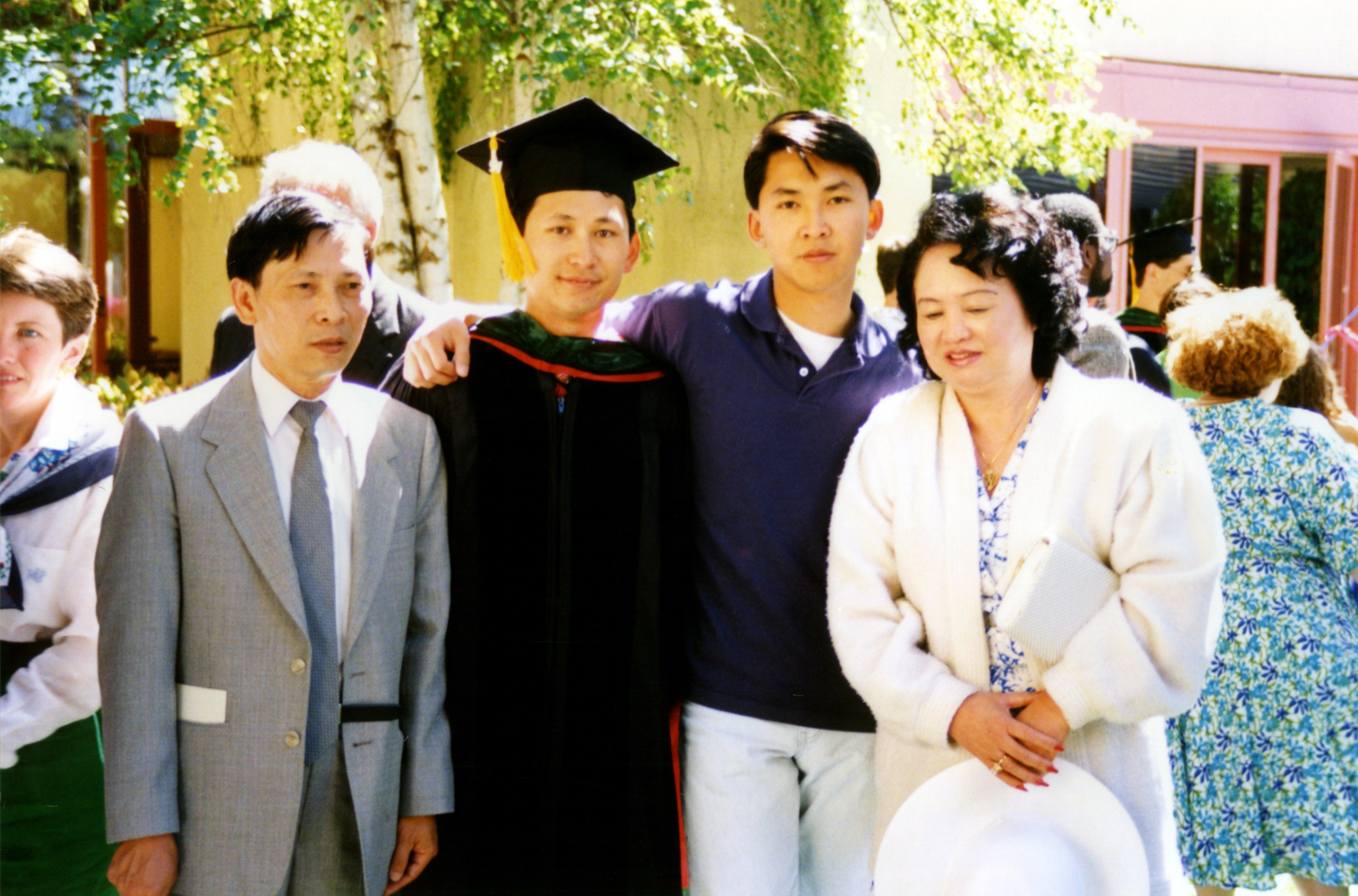 Tung with parents and brother