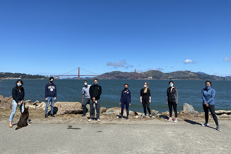 20-21 Interns spaced out with masks in front of Golden Gate Bridge